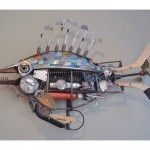 Tiger Fish, a found object assemblage by John Schwarz, is a prehistoric fish made of hockey sticks, golf clubs, and machine parts.