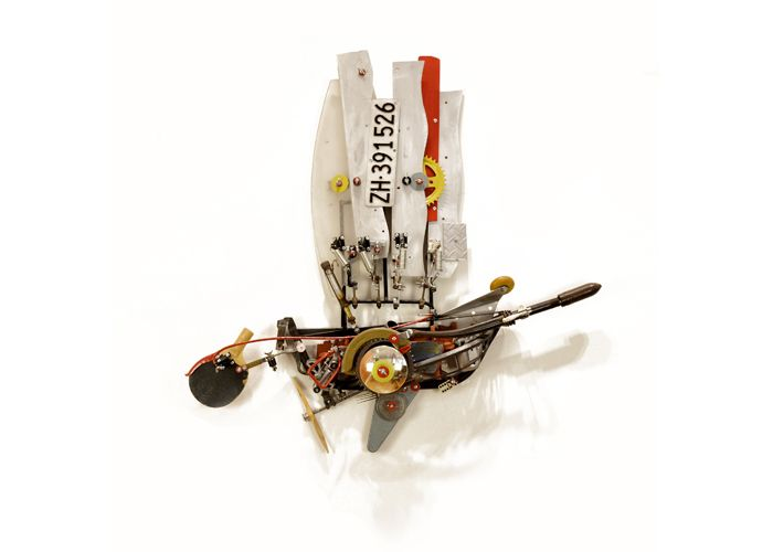 Clipper, a found object assemblage by John Schwarz. Boat shaped sculpture comprised of different mechanical parts.