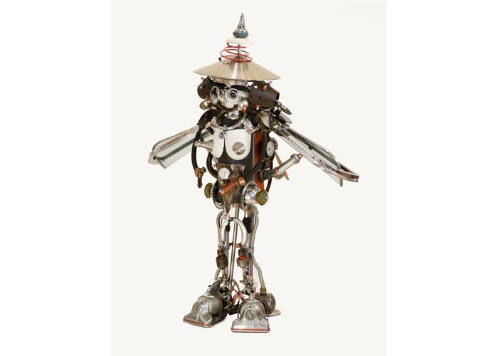 LuLu by John Schwarz, found object assemblage sculpture that appears to be wearing a hat.